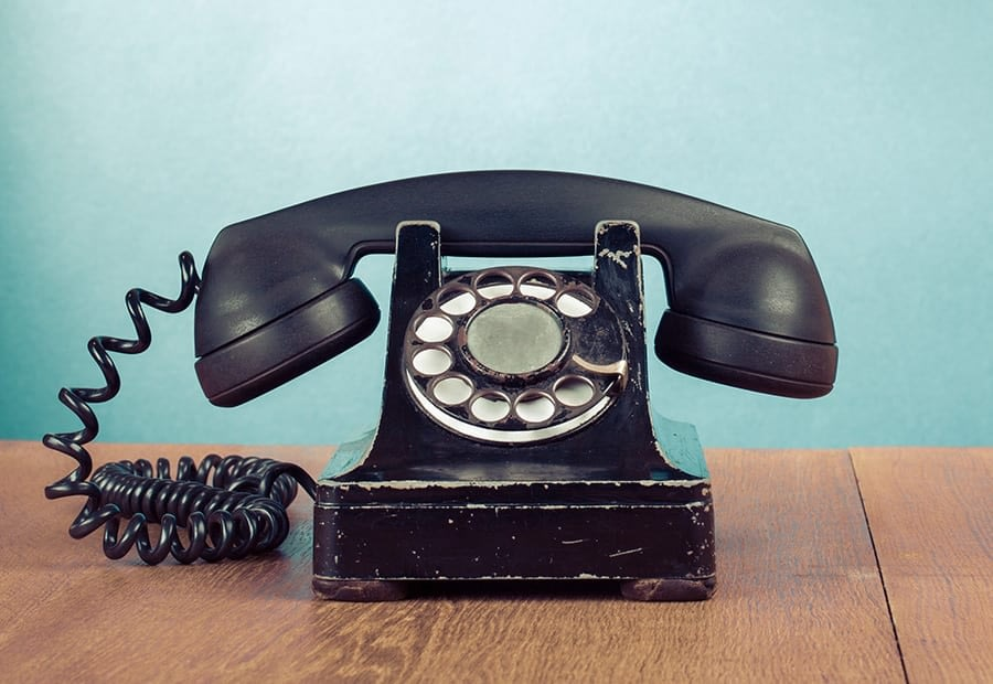 an antique phone on a wooden table to illustrate the concept of lead generation for attorney websites