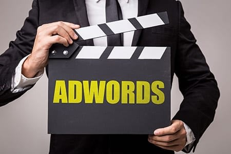 picture of man holding an adwords sign