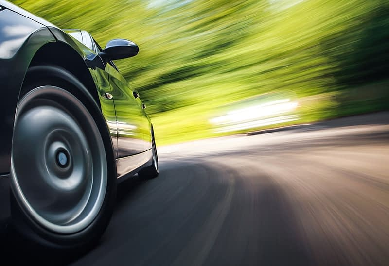 picture of a car going fast down a road to denote the idea of speed and performance for wordpress websites